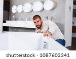 man customer choosing ceramic... | Shutterstock . vector #1087602341