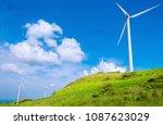 wind turbine on a meadow | Shutterstock . vector #1087623029