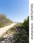 sandy path to the beach between ... | Shutterstock . vector #1087629281