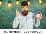teacher in eyeglasses holds... | Shutterstock . vector #1087659329