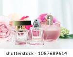 perfume bottles with flowers | Shutterstock . vector #1087689614