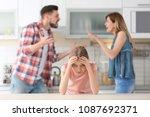 little unhappy girl sitting at...   Shutterstock . vector #1087692371