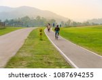 people exercise by cycling on a ... | Shutterstock . vector #1087694255