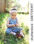 cute little girl and cherry... | Shutterstock . vector #1087735397
