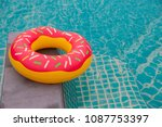 rubber ring in blue swimming... | Shutterstock . vector #1087753397