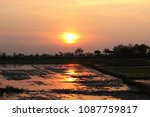 sunset in the rice fields with... | Shutterstock . vector #1087759817