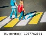 little boy and girl holding... | Shutterstock . vector #1087762991