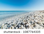 White Pebbles And Turquoise Se...