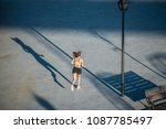 young fit blonde woman running... | Shutterstock . vector #1087785497
