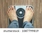male on the weight scale for... | Shutterstock . vector #1087799819