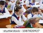 pupils at the desk think and... | Shutterstock . vector #1087820927