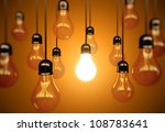 idea concept with light bulbs on a orange background - stock photo