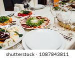 served dishes to the table for... | Shutterstock . vector #1087843811