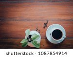 cup of coffee and small plant... | Shutterstock . vector #1087854914