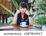 tired bored girl sitting and... | Shutterstock . vector #1087854917