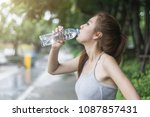 young sport woman drinking... | Shutterstock . vector #1087857431