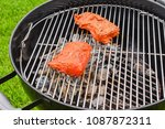 raw marinated beef steak on the ... | Shutterstock . vector #1087872311