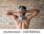 muscular bodybuilder guy doing... | Shutterstock . vector #1087885061