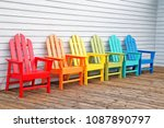 colorful  wooden chairs on... | Shutterstock . vector #1087890797