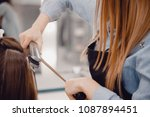 close up of master hairstylist... | Shutterstock . vector #1087894451