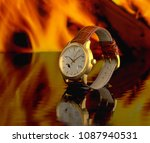 golden wristwatch in the water... | Shutterstock . vector #1087940531