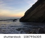 sunset behind cliff on the...