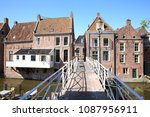 historic downtown in appingedam ... | Shutterstock . vector #1087956911