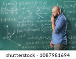 man on background mathematical... | Shutterstock . vector #1087981694
