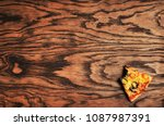 bitten slice of a pizza with... | Shutterstock . vector #1087987391