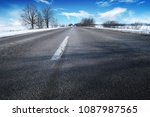 empty winter countryside road... | Shutterstock . vector #1087987565