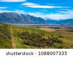 a stream flows through a valley ... | Shutterstock . vector #1088007335