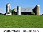 Small photo of barn and silo