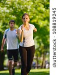 young couple jogging in park at ... | Shutterstock . vector #108819245