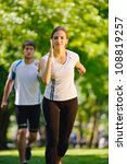 young couple jogging in park at ... | Shutterstock . vector #108819257
