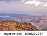 people standing on top of pikes ... | Shutterstock . vector #1088202857