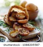 baked potatoes. baked halves of ... | Shutterstock . vector #1088205587