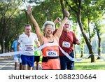 happy senior running through... | Shutterstock . vector #1088230664