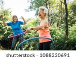 senior woman exercising with a... | Shutterstock . vector #1088230691