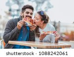 couple eating pizza outdoors... | Shutterstock . vector #1088242061