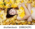 naked girl lies in maple leaves ... | Shutterstock . vector #108824291