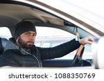 portrait of man in his car....   Shutterstock . vector #1088350769