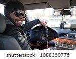 portrait of man in his car....   Shutterstock . vector #1088350775