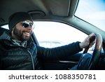 portrait of man in his car....   Shutterstock . vector #1088350781