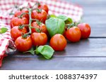 fresh tomatoes and basil on a... | Shutterstock . vector #1088374397