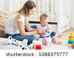 toddler boy playing with mother ... | Shutterstock . vector #1088375777