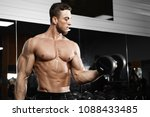muscular man working out in gym ... | Shutterstock . vector #1088433485