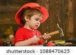 kid boy hammering nail into... | Shutterstock . vector #1088470625