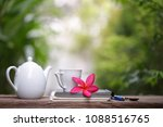 white kettle and cup with... | Shutterstock . vector #1088516765