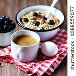 a healthy breakfast   oatmeal... | Shutterstock . vector #1088559077