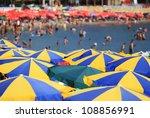 Stripped Beach Umbrellas Peopl...
